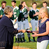 Don Knight | The Herald Bulletin<br /> Kathy Muller awards Tracy Harvey the Nick Muller Memorial Scholarship before the Muller Tournament championship at Memorial Field on Saturday.