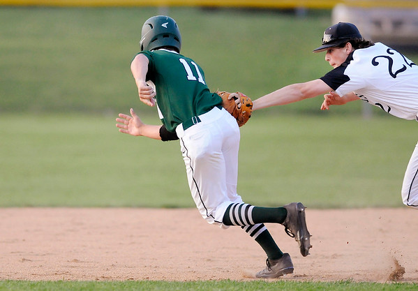 Don Knight | The Herald Bulletin<br /> Lapel's Satchell Wilson tags Pendleton Heights' Evan Douglas out in a run down between second and third base during the Nick Muller Tournament championship at Memorial Field on Saturday.