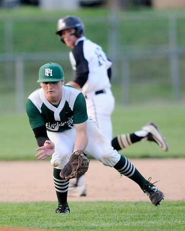 Don Knight   The Herald Bulletin<br /> Pendleton Heights' Matt Vetor fields the ball during the Nick Muller Tournament championship at Memorial Field on Saturday.