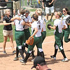 Photo by Chris Martin for The Herald Bulletin.  Pendleton players celebrate after the final out of the 2017 Madison County Softball Tournament. Pendleton Heights defeated Madison Grant 1-0 to win the 2017 Madison County Tournament.