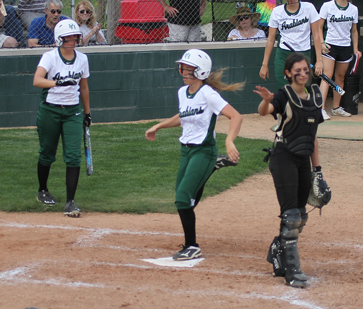 Photo by Chris Martin for The Herald Bulletin.  Pendleton's Savannah Hawhee crosses home plate Saturday for the games only run against Madison-Grant.  Pendleton Heights defeated Madison Grant 1-0 to win the 2017 Madison County Tournament.