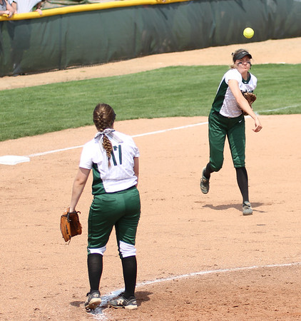 Photo by Chris Martin for The Herald Bulletin.  Pendleton third baseman Ashley King throws a runner out at first against Madison-Grant Saturday.  Pendleton Heights defeated Madison Grant 1-0 to win the 2017 Madison County Tournament.