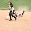 Photo by Chris Martin for The Herald Bulletin.  Pendleton's Ashley King slides into second base Saturday against Madison-Grant. Pendleton Heights defeated Madison Grant 1-0 to win the 2017 Madison County Tournament.