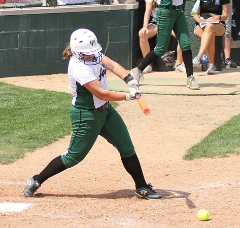 Photo by Chris Martin for The Herald Bulletin. Pendleton's Kelsey Sturgeon gets a basehit Sturday against Madison-Grant.  Pendleton Heights defeated Madison Grant 1-0 to win the 2017 Madison County Tournament.