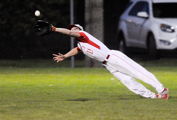 Don Knight | The Herald Bulletin<br /> Frankton's Brock Threet makes a diving catch in the outfield as the Eagles faced Pendleton Heights in championship game of the Nick Muller Memorial Baseball Tournament at Memorial Field on Saturday.
