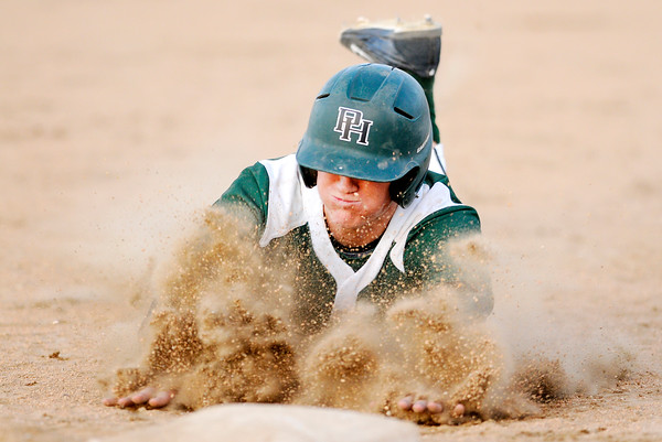 Don Knight | The Herald Bulletin<br /> Pendleton Heights' Logan Robertson slides into third as the Arabians faced Frankton in the Nick Muller Memorial Baseball Tournament championship game at Memorial Field on Saturday.