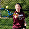 Alexandria's #1 singles player Reiley Hiser returns a forehand shot during her match with Alexandria's Abby Williams.