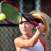 Frankton's Abby Hartley returns a shot to her opponent, Kelsey Rhoades of Alexandia, during their #3 singles match in the Madison County tennis finals Friday. Hartley won the match in three sets to score Frankton's only point.