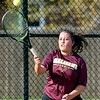 Alexandria's Kelsey Rhoades hits her shot against Abby Hartley of Frankton in their #3 singles match.