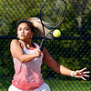 Frankton's #1 singles player Abby Williams follows through as she returns a shot during her match against Alexandria's Reiley Hiser.