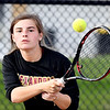 Alexandria #2 singles player Gracyn Hosier follows her shot during her match in the Madison County tennis finals. Hosier won the match 6-4, 6-1.