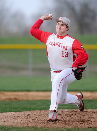 Don Knight | The Herald Bulletin<br /> Frankton's Blake Harless pitches for the Eagles as they hosted the Wapahani Raiders on Tuesday.