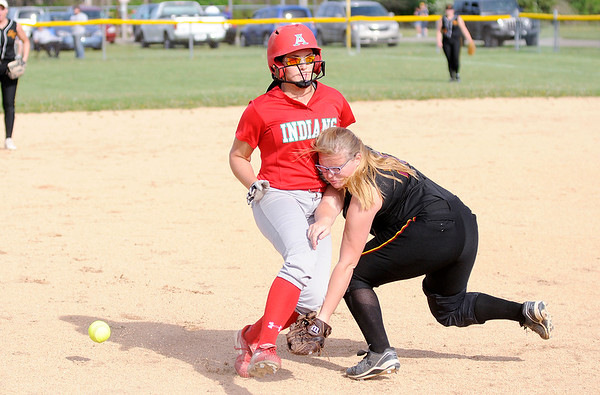 Don Knight | The Herald Bulletin<br /> Anderson's Sierra Cunningham collides with Alexandria's Haley Johnson at third base as the Indians  hosted the Tigers on Tuesday.