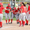 Don Knight | The Herald Bulletin<br /> The Indians meet Emma Kelley at home plate after she hit a three run home run as Anderson hosted the Alexandria Tigers on Tuesday.