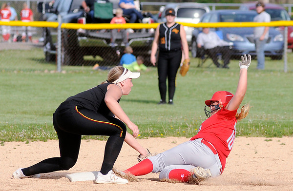 Don Knight | The Herald Bulletin<br /> Alexandria's Mackenzie McCarty tags Anderson's  Kalin Hubble out at second base on Tuesday.