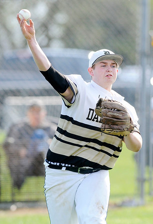 Don Knight | The Herald Bulletin<br /> Daleville's Jared Waltermire makes the throw to first after fielding the ball as the Broncos hosted the Alexandria Tigers on Wednesday.