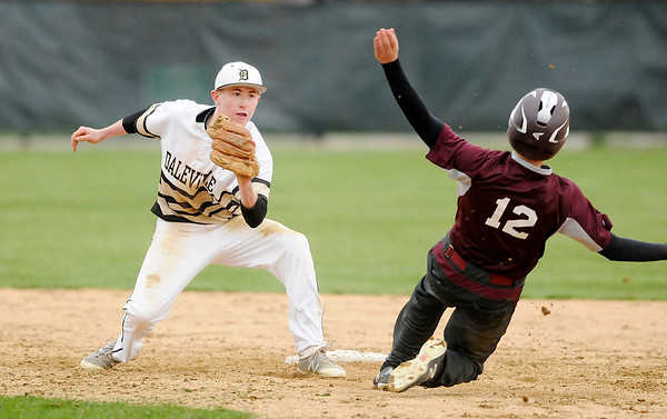 Don Knight | The Herald Bulletin<br /> Daleville's Max Stecher tags Alexandria's Brennan Morehead out at second as the Broncos hosted the Tigers on Wednesday.