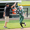 Don Knight | The Herald Bulletin<br /> Pendleton Heights' Amanda White high fives coach Rob Davis after hitting a grand slam as the Arabians hosted the Carmel Greyhounds on Wednesday.
