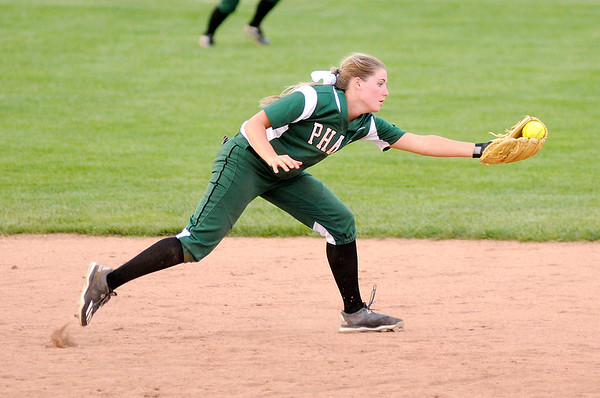 Don Knight | The Herald Bulletin<br /> Pendleton Heights' Lauren Landes fields a hit as the Arabians hosted the Carmel Greyhounds on Wednesday.