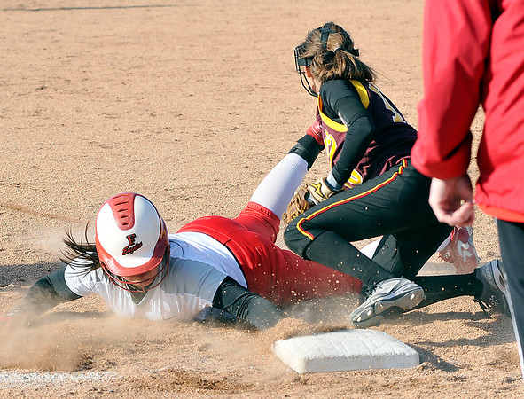 John P. Cleary | The Herald Bulletin  <br /> Frankton's Maddie Granger gets tagged out at third base by Alexandria's Alliyah Standridge in fifth inning action.