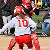 John P. Cleary | The Herald Bulletin  <br /> Alexandria's catcher Mackenzie Swango catches the ball as Frankton's Kyra Gunnell tries to score in the fourth inning and gets caught in a rundown and is tagged out.
