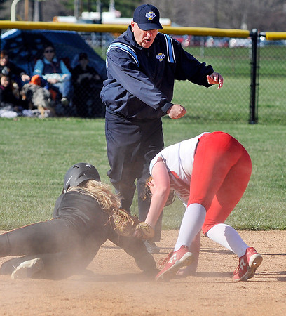 John P. Cleary | The Herald Bulletin  <br /> Frankton's Laikyn Lowe keeps the tag on Alexandria's courtesy runner, Leah McCormick, as she slides into second base while the umpire calls her out in second inning action.