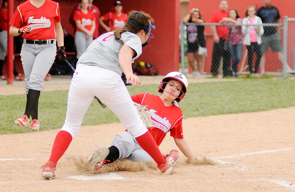 Don Knight | The Herald Bulletin<br /> Frankton's Brooke Campbell scores on a wild pitch as Anderson pitcher Sierra Cunningham covers home at Frankton on Wednesday.
