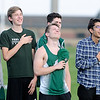 Don Knight | The Herald Bulletin<br /> Students look to the flag during the National Anthem before the start of the Pendleton Heights Boys Track Invitational on Thursday. The start was delayed when athletes and fans were evacuated to the auxiliary gym during a tornado warning.