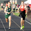 Don Knight | The Herald Bulletin<br /> Pendleton Heights' Parker Jones takes the lead at the finish winning the 4x800 relay for the Arabians during their Boys Track Invitational on Thursday. Other members of the relay team were Wren Parker, Cole Buck and Milan Jones.