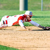 John P. Cleary | The Herald Bulletin  <br /> Frankton's shortstop Brock Threet dives for a hard grounder off the bat of  Lapel's Levi Frazier in the fourth inning.