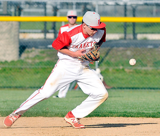 John P. Cleary | The Herald Bulletin  <br /> Frankton's second baseman Evan Doan gets handcuffed by a hard grounder but stays with the play to throw the batter out at first base.