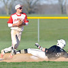 John P. Cleary | The Herald Bulletin  <br /> Frankton's Brock Threet looks to throw to first for a double play as Lapel's Cameron Holycross slides into second in the fifth inning.