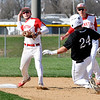 John P. Cleary | The Herald Bulletin  <br /> Frankton's shortstop Brock Threet throws to first for a double play in the first inning as Lapel's Devan Frank starts to slide into second.