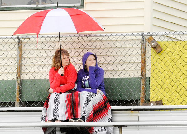 Don Knight | The Herald Bulletin<br /> Spectators try to stay dry druing the Pendleton Heights Boys Track Invitational on Thursday.