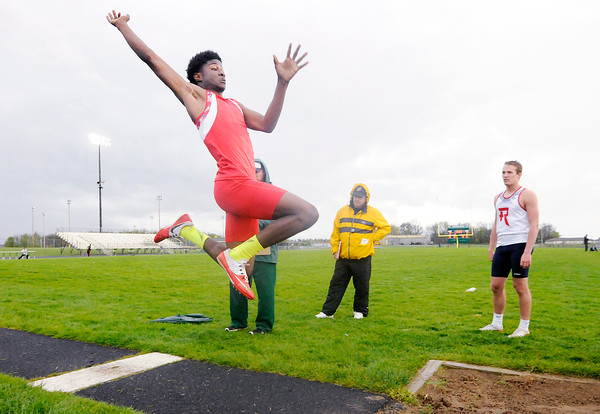 Don Knight | The Herald Bulletin<br /> Anderson's Dey McIntosh competes in the long jump during the Pendleton Heights Boys Track Invitational on Thursday.