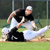 John P. Cleary | The Herald Bulletin <br /> Lapel's #7, Cannon Bledsoe, avoids the tag of Daleville's third baseman Jared Waltermire for a first inning triple.
