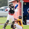 Don Knight | The Herald Bulletin<br /> Alexandria's Bub Misner collides with Elwood catcher Josh Parish on Tuesday. Parish held onto the ball and Misner was called out.