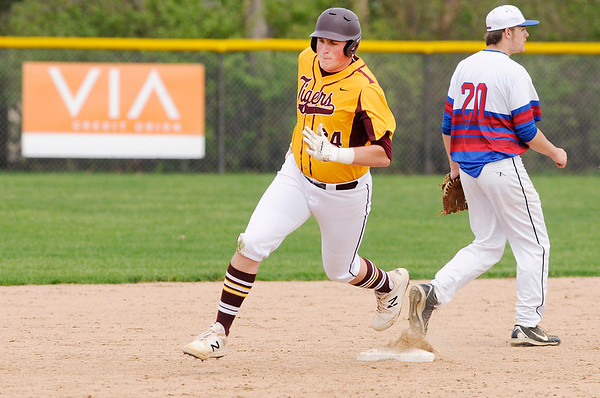 Don Knight   The Herald Bulletin<br /> Alexandria's Nick Williams rounds second as the Tigers traveled to Elwood on Tuesday.