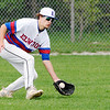 Don Knight | The Herald Bulletin<br /> Elwood's Chris Hawes fields a hit in left field as the Panthers hosted the Alexandria Tigers on Tuesday.