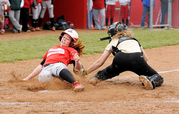 Don Knight   The Herald Bulletin Frankton's Laikyn Lowe is tagged out by Madison-Grant's Zoey Barnett on Tuesday.