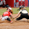 Don Knight | The Herald Bulletin<br /> Frankton's Laikyn Lowe is tagged out by Madison-Grant's Zoey Barnett on Tuesday.