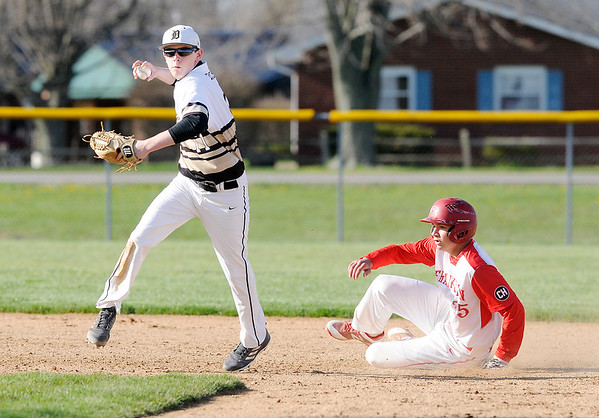 Don Knight | The Herald Bulletin<br /> Daleville's Blaine Tighe attempts to turn a double play after forcing Frankton's JJ Hatzell out at second on Wednesday.