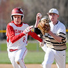 Don Knight | The Herald Bulletin<br /> Frankton's Ethan Friend runs to first base as he is chased by Daleville's Max Stecher on Wednesday.