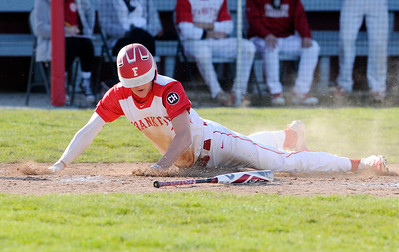 Don Knight   The Herald Bulletin Frankton's Landon Weins slides safely into home to give the Eagles a 3-2 lead over Daleville in the bottom of the third on Wednesday.