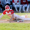 Don Knight | The Herald Bulletin<br /> Frankton's Landon Weins slides safely into home to give the Eagles a 3-2 lead over Daleville in the bottom of the third on Wednesday.