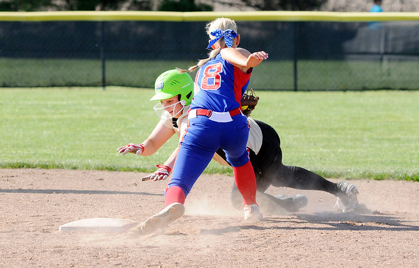 Don Knight | The Herald Bulletin<br /> Elwood's Emily Booker tags Madison-Grant's McKenna Lugar out as she attempts to steal second on Thursday.