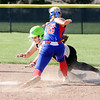 Don Knight   The Herald Bulletin<br /> Elwood's Emily Booker tags Madison-Grant's McKenna Lugar out as she attempts to steal second on Thursday.