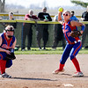 Don Knight | The Herald Bulletin<br /> Elwood's Emily Booker makes the throw to first as Shantel Blackford looks on as Madison-Grant hosted the Panthers on Thursday.