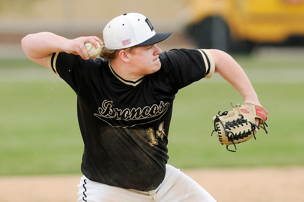 Don Knight | The Herald Bulletin<br /> Daleville's Peyton Smith throws to first after fielding the ball as the Broncos hosted Monroe Central on Wednesday.