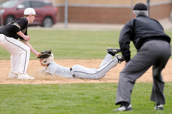 Don Knight | The Herald Bulletin<br /> Daleville short stop Max Stecher tags Monroe Central's Jordan Willen out as he attempts to steal second base on Wednesday.